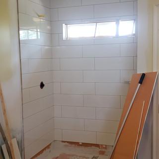 Floor to ceiling tile walk in shower