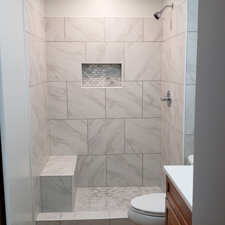 Custom tile walk in shower with bench