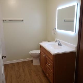 Backlit bathroom vanity mirror installation