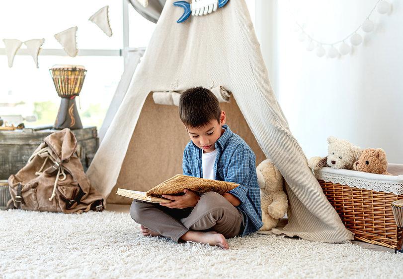 bigstock-Little-boy-reading-paper-book--