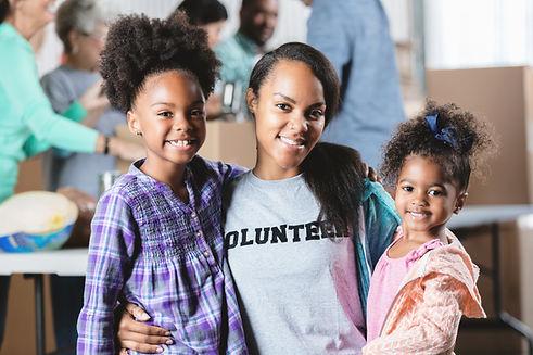young volunteer with children