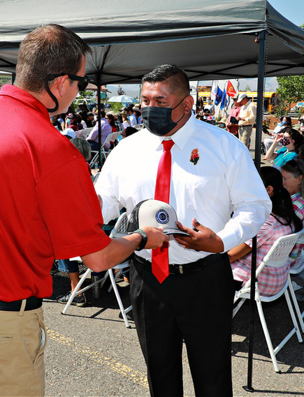 Wind River Veteran being presented with gift hat