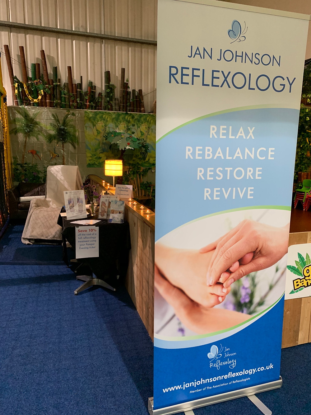 La Fuma recliner chair and table with information about reflexology. Jan Johnson Reflexology offered 20 minute taster sessions at the Pamper Evening.