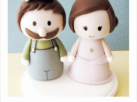 Nerd creations:  Luigi and Peach custom cake topper. Visit nerd theme in our Gallery.