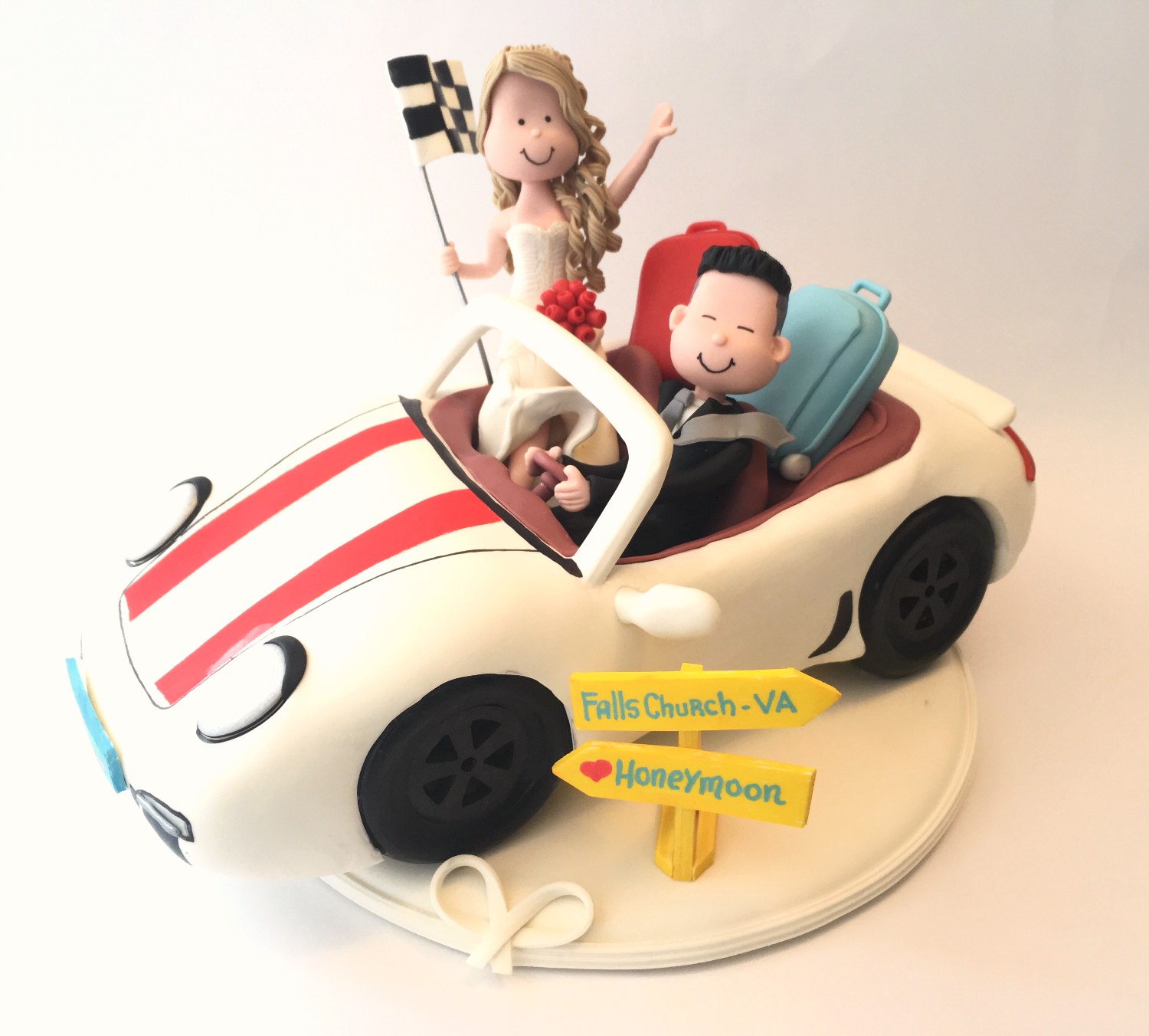 wedding-cake-topper-bride-and-groom-traveling-car