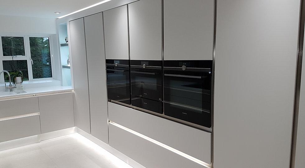 Crown Kitchens. Zeluso Matt Silk Grey. Corian Designer White Worktops