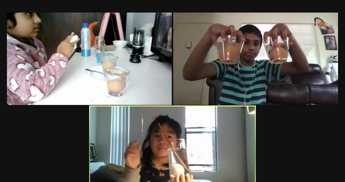 Students in an environmental science class take a group photo, showing their egg experiments.