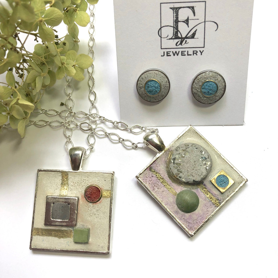 "•Blue Dot Concrete post Earrings. Size:  12mm  Materials:  Stainless steel stud earrings, gray and blue concrete.   • Square Necklaces Size: 1"" x 1""  Materials: Silver plate square bezel, concrete,16"" plus 2"" extension silver plate chain.  Codes: (L) NC396 ~SOLD~ (R) NC397 ~SOLD~"