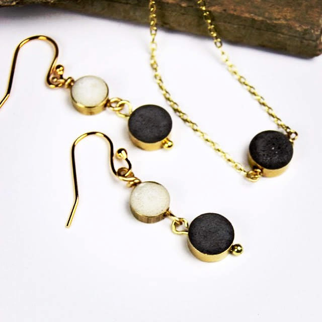 "• Black Necklace Materials:  Black concrete, Brass pandent and glod plated 16"" chain.   Code:  NC340 $28   • Black & White Earrings.  Size:  Approx 7/16"" x 1 3/4""  Materials:  Brass, black and white concrete, gold plated hypoallergenic earring's hook.  Code:  ER819 $30"