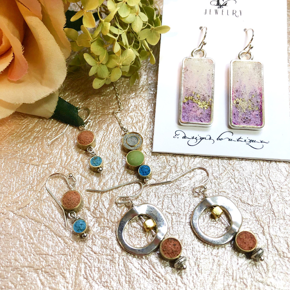 "• Purple & White with Gold Flakes Rectangle Errings. Size: 1/2"" x 1""  Materials: Silver plated rectangle bezel, purple and white concrete, Sterling Silver earring's hook.  Code: ER949 $22   •Concrte, Terracotta Hanging, Earrings. Size: 5/8"" x 1 1/2""   (Available in: Green, red, terracotta, yellow, blue, white and black)  *Please specify color when ordering.  Materials:  Brass, Silver Plated  beads.  Code:  ER962-2 $28   •Terracotta and Blue Earrings. Size:  1/4"" x 1 1/4""  Materials: Brass bezels, sterling silver earring's hook.  Code: ER968 $30   •Gray, Green & Blue slim Necklace. Size: 3 1/4""  Materials: Brass Bezels, 20"" gold plated chain.  Code: NC351-2 $39"