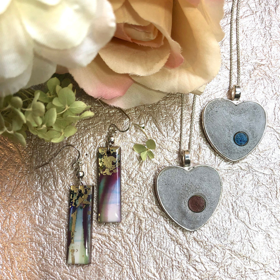 "• Heart Neckles Size: 1"" x 1""  Materials:  Silver plated heart pendant,Concrete and 17"" Sterlin Silver Chain.  Code: Red NC362-2 Blue NC362-3 $50   • Alcohol Ink Earrings One-of-a-kind ~SOLD~"