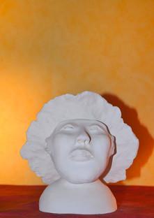 Réalisation d'une tête coiffée d'un chapeau