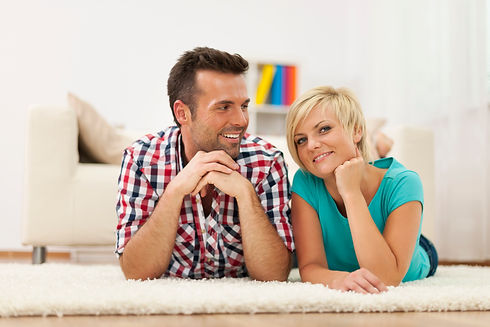 couple-lying-down-on-carpet-at-home-27KQ