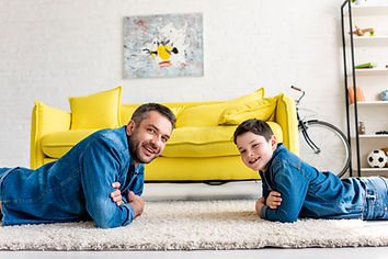 happy-father-and-son-in-denim-with-crossed-arms-ly-5ZFU29N.jpg