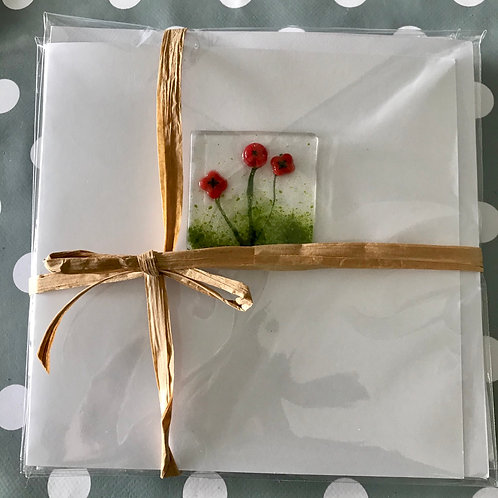 Pack of four assorted glass cards.