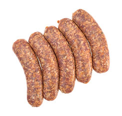 Top view of spicy bratwurst links on a w