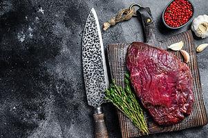 Venison raw deer meat on a cuuting board