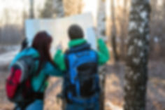Young couple hikers looking at map..jpg