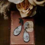 Zilveren blaadjes oorbellen met montana agaat