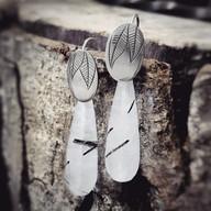 Zilveren blaadjes oorbellen met rutielkwarts