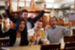 People in bar watching TV.jpg