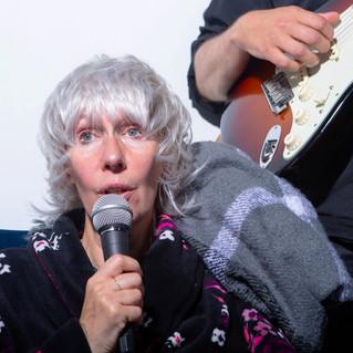 Kathleen singing with mic.jpeg