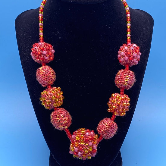 "Necklace- yarn/ bead ball necklace 20"" length."