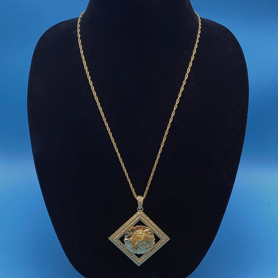 """Necklace- Monet pendant on gold tone signed NS chain/ length 36"""" with pendant."""