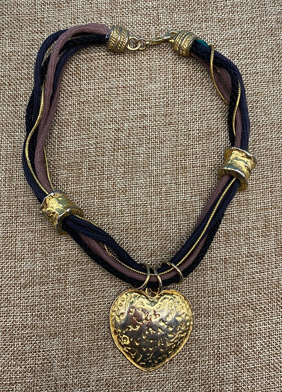 """Necklace- 1970's influence gold tone heart, black-brown-gold twine, 17"""" length."""