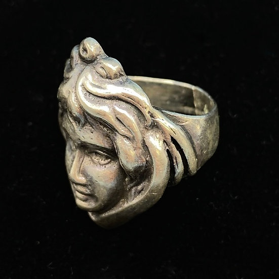 Ring-Sterling silver etched face motif, size small.