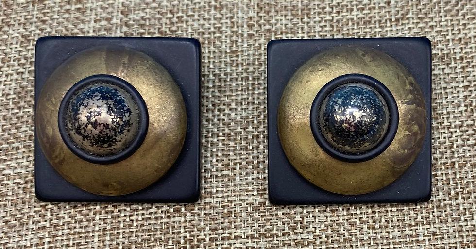 Pierced earrings- Raised brass on Faux black lucite 1980's.