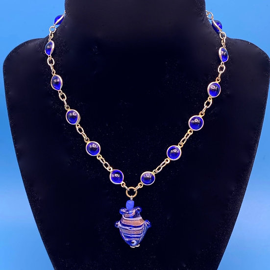"Cobalt blue circular necklace with fish pendant length 14"" including pendant."