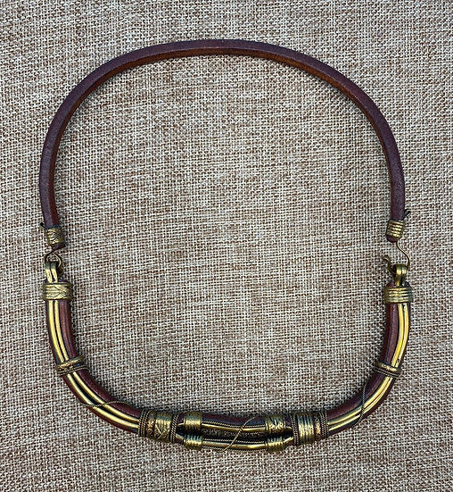 Necklace- Leather/brass (with etched motif) closure on left side.