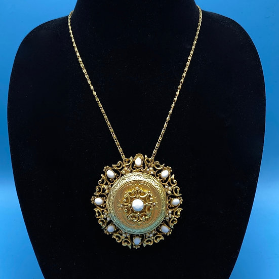 "Signed Florenza gold tone filigree locket (opens) 38"" long with pendant."