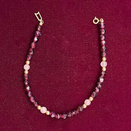 """Bracelet: garnet/moonstone/gold. Length 7""""."""
