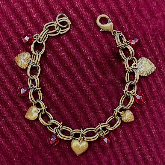 """Charm Bracelet- Red crystals/ small brass hearts Length 7"""""""