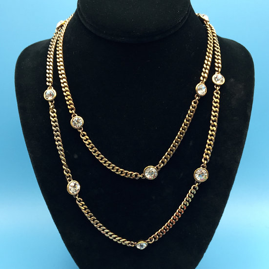 """Necklace- Signed Givenchy gold tone/crystal 40"""" in length."""