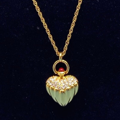 "Necklace-signed Joan Rivers gold tone beautiful heart pendant. L 36"" inc pendant"