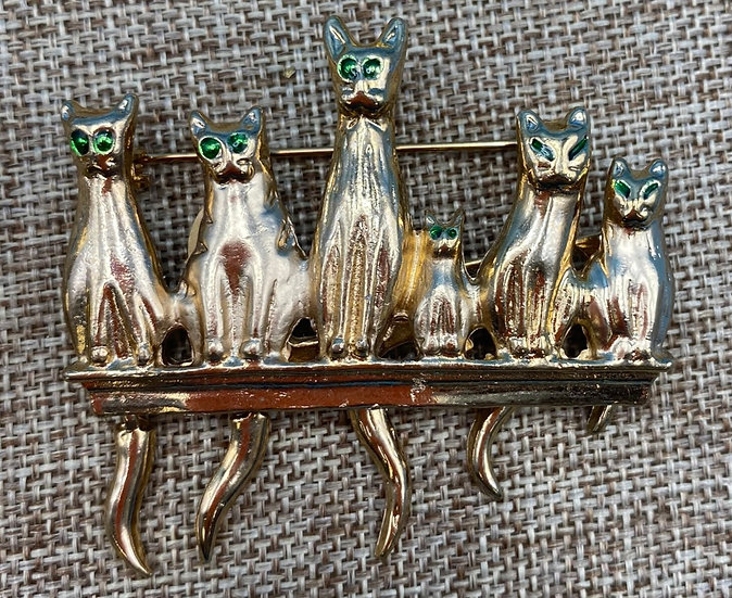 Pin- Six cats perched with hanging tails.