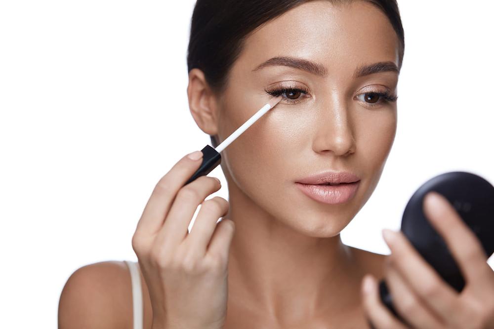Model Applying Concealer Corrector Under Eyes Makeup Blog