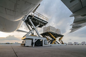 loading cargo outside cargo plane.jpg