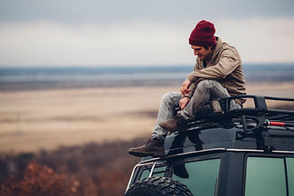 Guy Sitting on Car