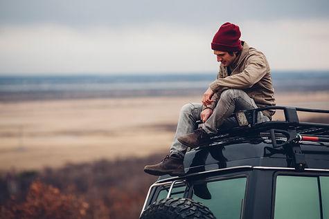 Guy Sitting on Car