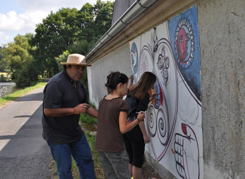 PAINTING A MURAL WITH STUDENTS