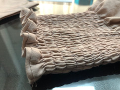 A detailed shot of smocked dress made at Billoomi Fashion