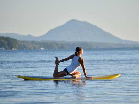THE BENEFITS OF PADDLEBOARD YOGA AND WHY YOU SHOULD DO IT