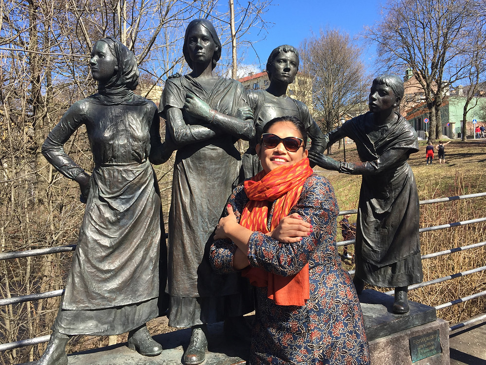 """Trade Union leader Nazma Aktar in from of the statue """"the factory girls"""" featuring seamstresses from the old textile factories along the Aker river in Oslo."""
