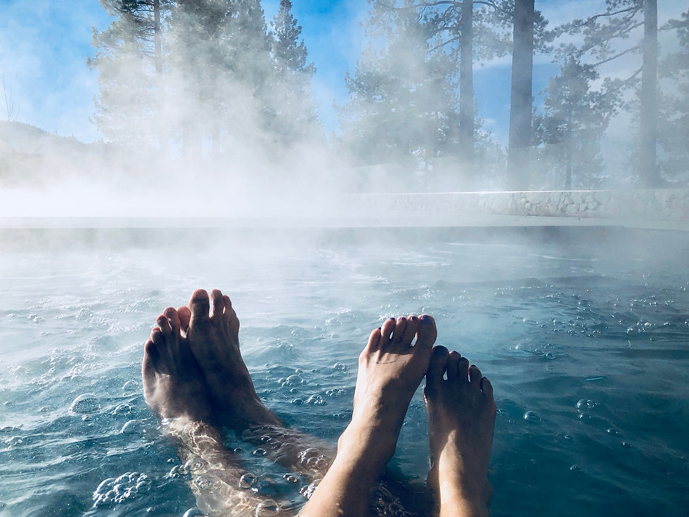 Couples Feet in Hot Tub Jacuzzi Spa Outd