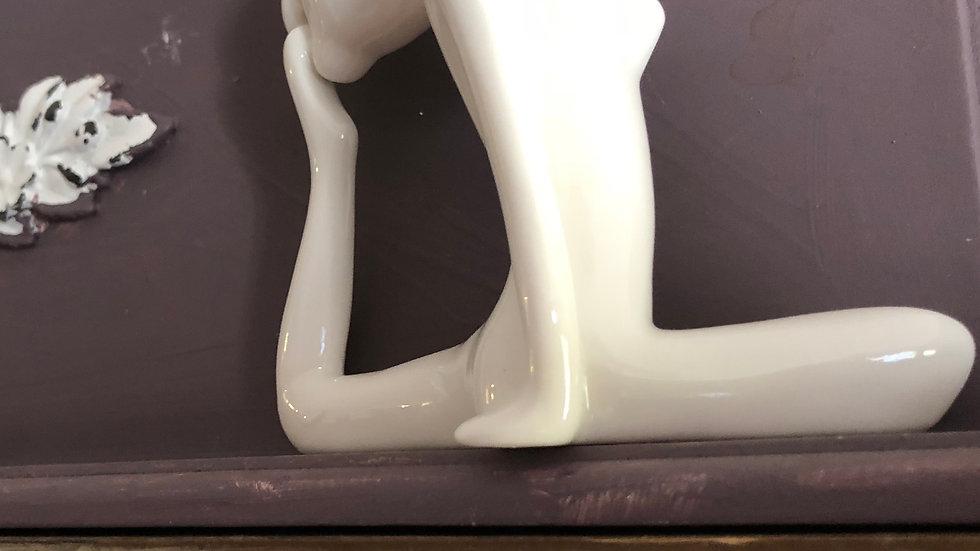Three porcelain yoga positions