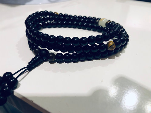 Armband of ketting obsidian